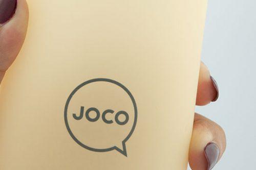 JOCO Reusable Glass Water Bottle Being Held