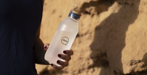 JOCO Reusable Glass Water Bottle Being Held